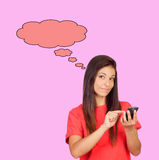 Attractive brunette girl dressed in red with a mobile thinking Royalty Free Stock Photo
