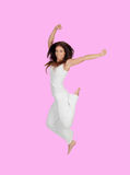 Attractive brunette girl dressed in white jumping Stock Photography
