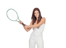Attractive brunette girl dressed in white playing tennis Stock Photos