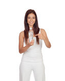 Attractive brunette girl dressed in white water bottle Royalty Free Stock Photography