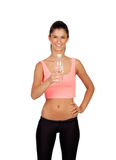 Attractive brunette girl drinking water during training Stock Image