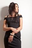 Attractive brunette girl in fashion black dress Stock Photography
