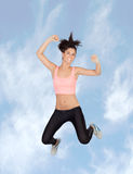 Attractive brunette girl with fitness clothing jumping Stock Photography
