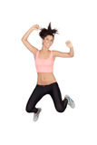 Attractive brunette girl with fitness clothing jumping Stock Image