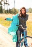 Attractive brunette girl during her cycling Stock Images