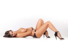 Attractive brunette girl lying on white floor Royalty Free Stock Photo