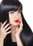 Attractive brunette girl model with long healthy hair styling, m. Akeup and manicured nails isolated on white background Stock Image