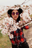 Attractive brunette girl near a almond tree with many flowers royalty free stock photo