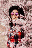Attractive brunette girl near a almond tree with many flowers stock images