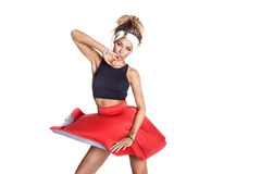 Attractive brunette girl posing. Attractive young brunette woman dancing, wearing red fashionable skirt. Studio conceptual photo Royalty Free Stock Photo