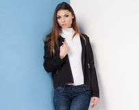 Attractive brunette girl posing. Attractive young woman posing in studio, wearing fashionable clothes Royalty Free Stock Photo