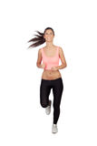 Attractive brunette girl running stock photo