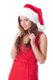 Attractive brunette girl in santa hat, isolated Stock Images
