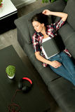 Attractive brunette girl sleeping on the sofa & x28;View from above& x29; Stock Photo