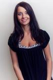 Attractive brunette girl smile. Attractive brunette girl, smile, black dress Royalty Free Stock Image