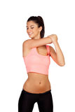 Attractive brunette girl stretching arms after the training Stock Image