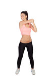 Attractive brunette girl stretching arms after the training Stock Photography