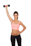 Attractive brunette girl tightening their muscles Royalty Free Stock Photo