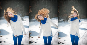 Attractive brunette girl with white sweater posing playing in winter scenery. Beautiful young woman with long hair enjoying snow Stock Image