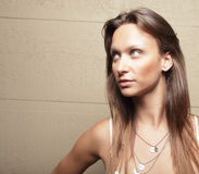 Attractive brunette glancing away Royalty Free Stock Photography