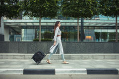 Attractive brunette going to airoport royalty free stock image
