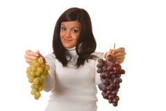Attractive brunette with grape Royalty Free Stock Image