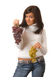 Attractive brunette with grape Royalty Free Stock Photography