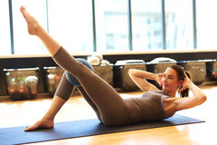 Attractive brunette in gym Stock Images