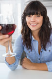 Attractive brunette having glass of red wine Royalty Free Stock Images