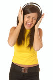 Attractive brunette with headphones Royalty Free Stock Photography