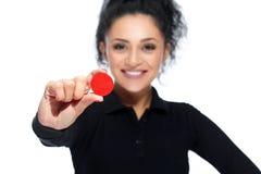 Attractive brunette holding casino tokens stock photos