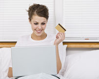 Attractive Brunette Holding Credit Card Royalty Free Stock Photography