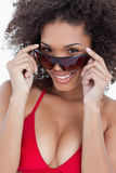 Attractive brunette holding her sunglasses Royalty Free Stock Photo