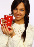 Attractive brunette holding a red mug Stock Image