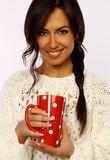 Attractive brunette holding a red mug Royalty Free Stock Image
