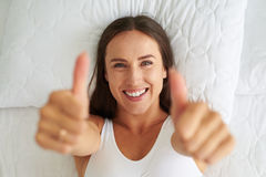 Attractive brunette holds her thumbs up Stock Image