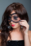 Attractive brunette with lacy mask on eyes Stock Image