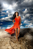 Attractive brunette lady posing at the beach. Royalty Free Stock Photos