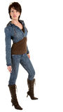 Attractive Brunette Lady Wearing Jeans and Boots Stock Images