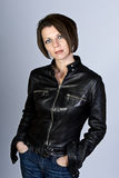 Attractive Brunette with Leather Jacket and Jeans Stock Photos