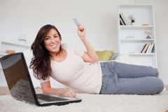 Attractive brunette making a payment with a laptop Stock Photo