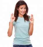 Attractive brunette making a wish with luck sign Stock Images
