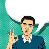 Attractive brunette man gesture hand ok. Attractive brunette, surprised young blue eyes man style pop art. Comic text pop art style vector. Sound comic bubble Royalty Free Stock Images