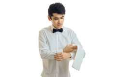Attractive brunette man waiter in unifrom and bowtie Royalty Free Stock Photography