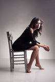 Brunette chair Royalty Free Stock Images