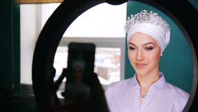 Attractive brunette model with wedding turban - photosession. Close up stock video footage