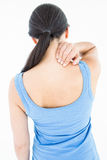 Attractive brunette with neck pain Royalty Free Stock Photography
