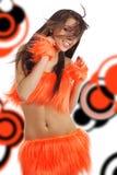 Attractive brunette in orange costume Stock Images