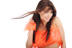 Attractive brunette in orange costume Royalty Free Stock Photography