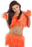 Attractive brunette in orange costume stock photos